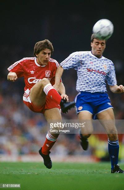 Liverpool striker Peter Beardsley outpaces United defender Mal Donaghy to score his third and Liverpool's fourth goal during the First Division match...