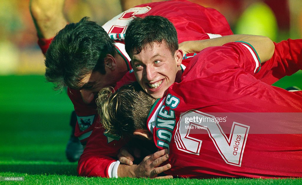 Liverpool striker Robbie Fowler (c) celebrates with Ian Rush (L) and Rob Jones after scoring the second goal in an FA Premier League match between Liverpool and Aston Villa at Anfield on October 8, 1994 in Liverpool, England.