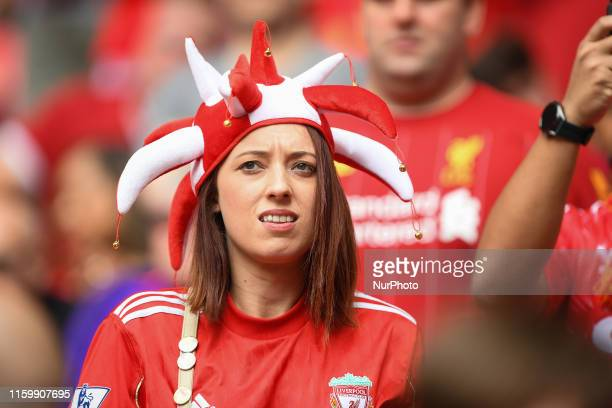 Liverpool supporter with jester hat during the FA Community Shield match between Manchester City and Liverpool at Wembley Stadium London on Sunday...