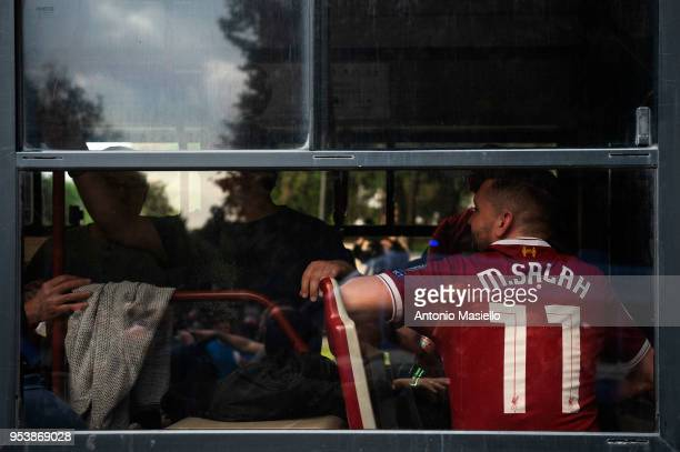 Liverpool supporter with the Salah player's shirt as he travels on a special bus to The Olympic Stadium before of the UEFA Champions League semifinal...