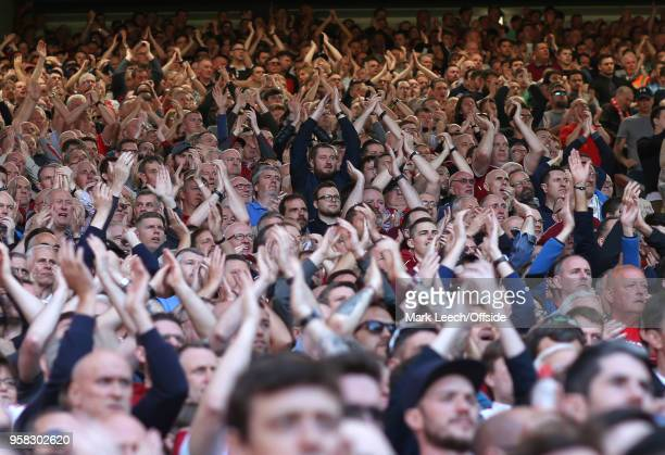 Liverpool supporters applauding on the Spion Kop during the Premier League match between Liverpool and Brighton and Hove Albion at Anfield on May 13...