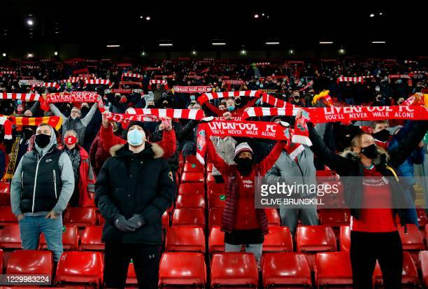 Liverpool supporters arrive for the English Premier League football match between Liverpool and Wolverhampton Wanderers at Anfield in Liverpool,...