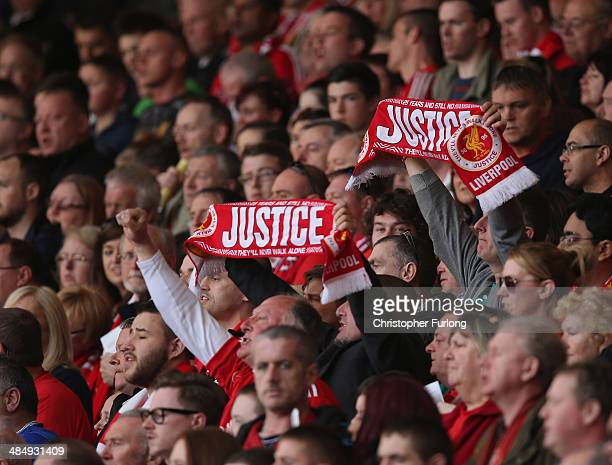 Liverpool supporters attend the memorial service marking the 25th anniversary of the Hillsborough Disaster at Anfield stadium on April 15 2014 in...