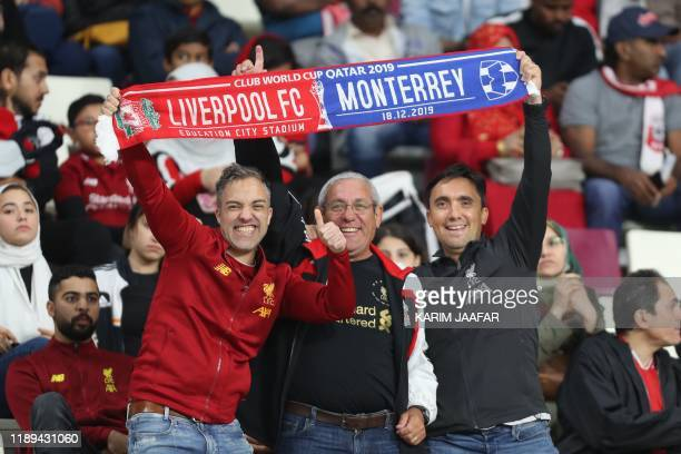 Liverpool supporters cheer ahead of the 2019 FIFA Club World Cup semifinal football match between Mexico's Monterrey and England's Liverpool at the...