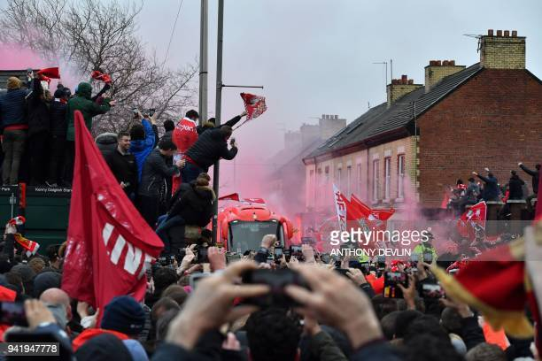 Liverpool supporters greet the arrival of Liverpool players before the UEFA Champions League first leg quarterfinal football match between Liverpool...