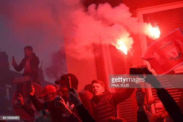 Liverpool supporters greet the arrival of players at the stadium before the UEFA Champions League first leg quarterfinal football match between...