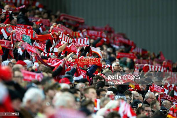 Liverpool supporters hold up their scarves as they sing prior to The Emirates FA Cup Fourth Round match between Liverpool and West Bromwich Albion at...