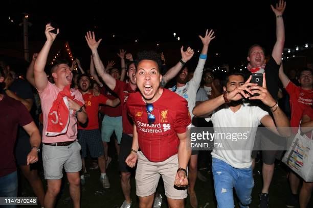 Liverpool supporters in Flat Iron Square in London react to their team lifting the trophy as they watch the UEFA Champions League final football...