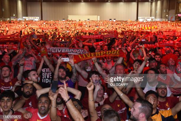 Liverpool supporters in the MS Bank Arena in Liverpool sing the club anthem you'll never walk alone after their team lifts the trophy as they watch...