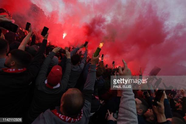 Liverpool supporters light flares as the bus carrying the Liverpool team arrives for the UEFA Champions league semi-final second leg football match...