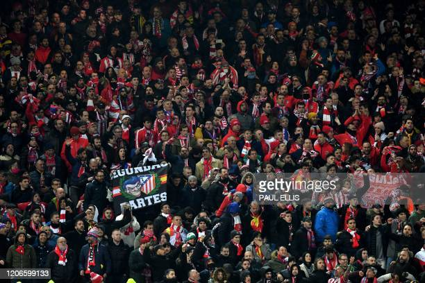 Liverpool supporters look on during the UEFA Champions league Round of 16 second leg football match between Liverpool and Atletico Madrid at Anfield...