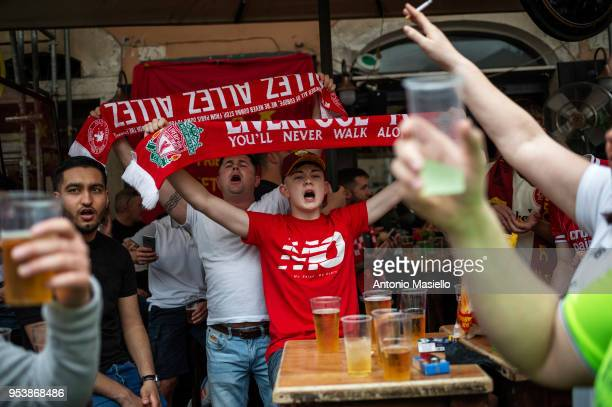 Liverpool supporters shout slogans ahead of the UEFA Champions League semifinal football match AS Roma against Liverpool FC on May 2 2018 in Rome...