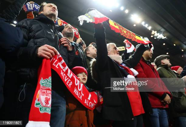 Liverpool supporters sing 'You'll Never Walk Alone' as the players enter the field of play ahead of the UEFA Champions League group E match between...