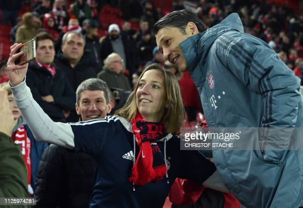 Liverpool supporters take a picture with Bayern Munich's Croatian head coach Niko Kovac prior the UEFA Champions League round of 16 first leg...