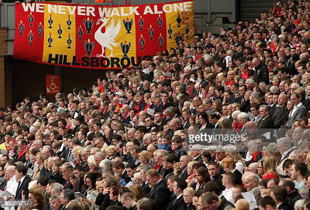 Liverpool supporters take part in a minutes silence during the Hillsborough memorial at Anfield on April 15 Liverpool, England. Thousands of fans,...