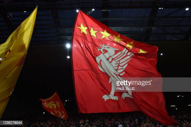 Liverpool supporters wave banners featuring the 'liver bird' of Liverpool FC's crest ahead of the UEFA Champions League 1st round Group B football...