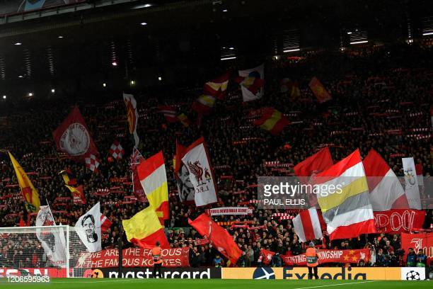 Liverpool supporters wave flags before the UEFA Champions league Round of 16 second leg football match between Liverpool and Atletico Madrid at...