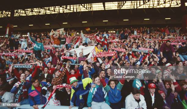 Liverpool supporters wave their scarves in the 'Kop End' during a First Division match against Manchester United on Aapril 26 1992 in Liverpool...