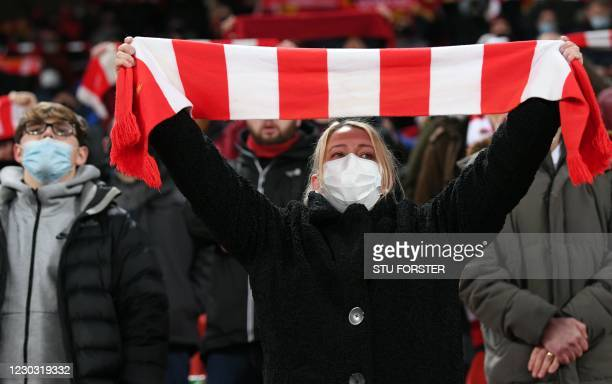 Liverpool supporters wearing masks in the Kop during the English Premier League football match between Liverpool and West Bromwich Albion at Anfield...