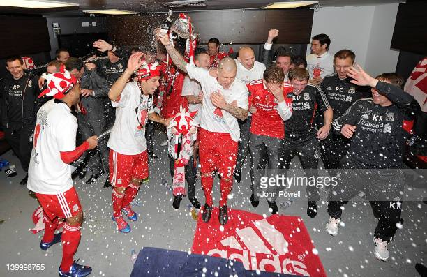 Liverpool team celebrate at the end of the Carling Cup Final match between Liverpool and Cardiff City at Wembley Stadium on February 26 2012 in...