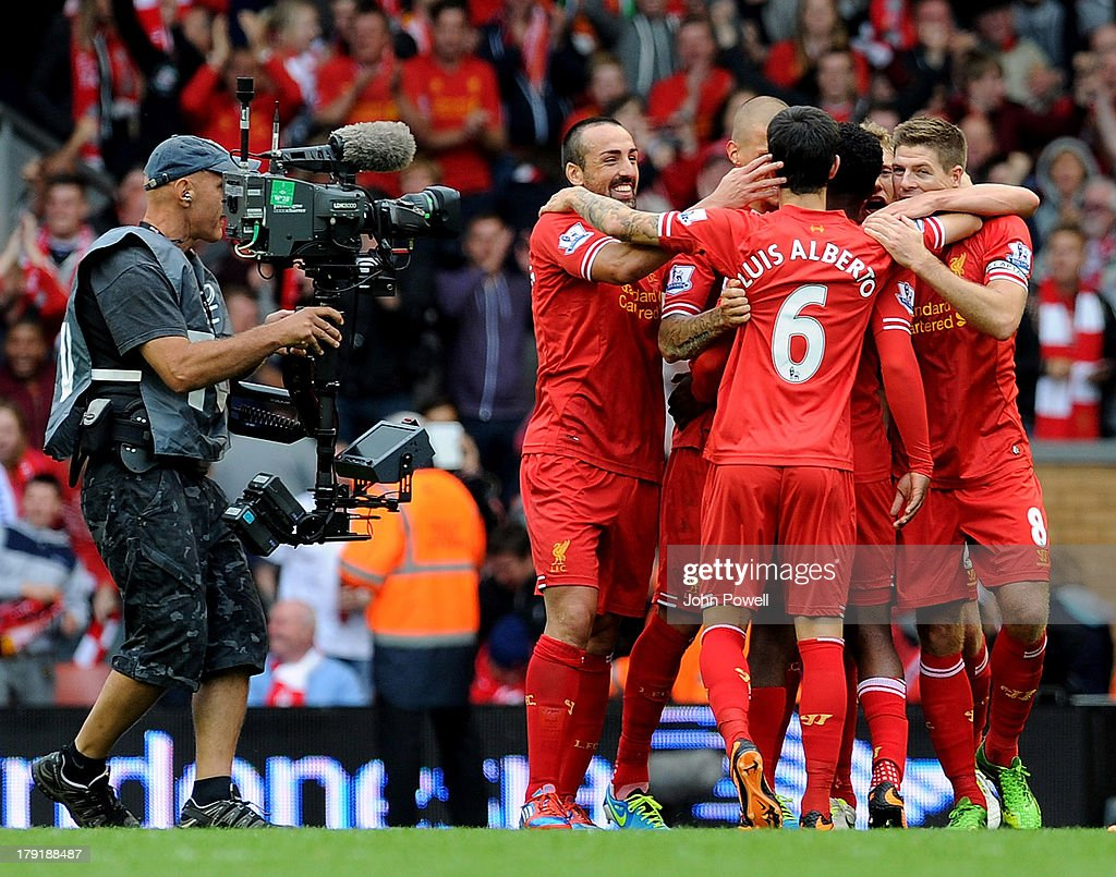 Liverpool team celebrate the win at the end of the Barclays Premier League match between Liverpool and Manchester United at Anfield on September 01, 2013 in Liverpool, England.