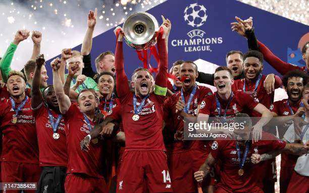 Liverpool team celebrate with the Champions League Trophy after winning the UEFA Champions League Final between Tottenham Hotspur and Liverpool at...