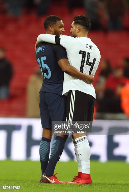 Liverpool team mates Joe Gomez of England and Emre Can of Germany embrace at full time after the International Friendly fixture between Germany and...