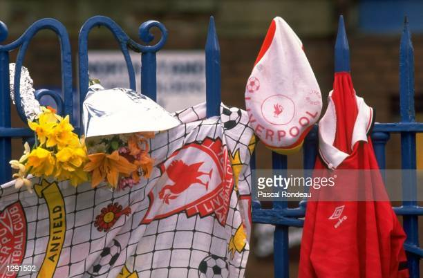 Liverpool team memorabilia hangs from a fence in tribute after the disaster at Hillsborough in Sheffield England Mandatory Credit Pascal...