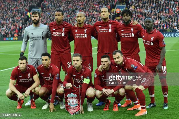 Liverpool team pose before the UEFA Champions league semifinal second leg football match between Liverpool and Barcelona at Anfield in Liverpool...