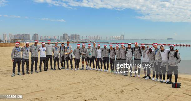 Liverpool team pose for a photograph with the Club World Cup trophy with Santa hats on to wish everyone a Merry Christmas on December 22 2019 in Doha...