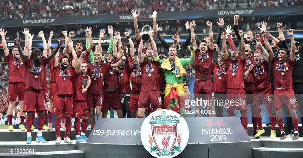 Liverpool team poses with the trophy after winning the UEFA Super Cup 2019 football match between FC Liverpool and FC Chelsea at Besiktas Park...