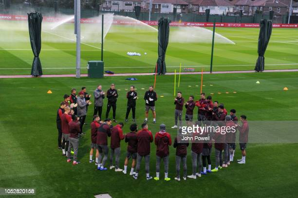 Liverpool team sing Happy Birthday to Fabinho before a training session at Melwood Training Ground on October 23 2018 in Liverpool England