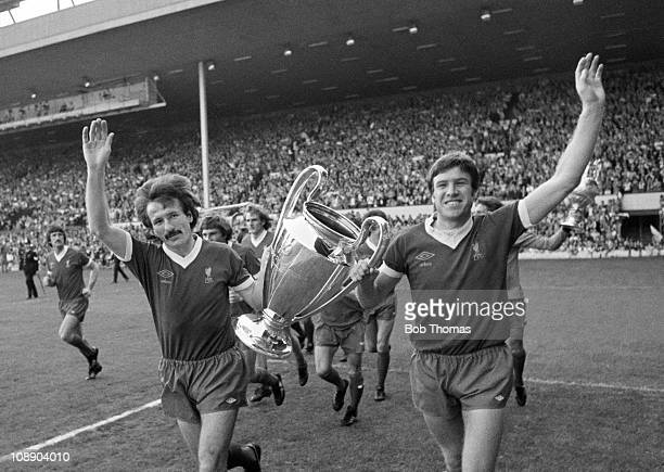 Liverpool teammates Tommy Smith and Emlyn Hughes parade the European Cup at Anfield prior to the Tommy Smith Testimonial match on 27th May 1977...