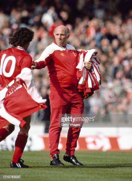 Liverpool trainer Ronnie Moran collects an Umbro tracksuit top from player Craig Johnston during the warm up before the 1983 League Cup Final against...
