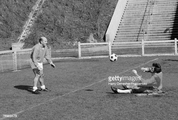 Liverpool trainer Ronnie Moran puts goalkeeper Ray Clemence through his paces during a training session prior to the European Cup Quarter Final...