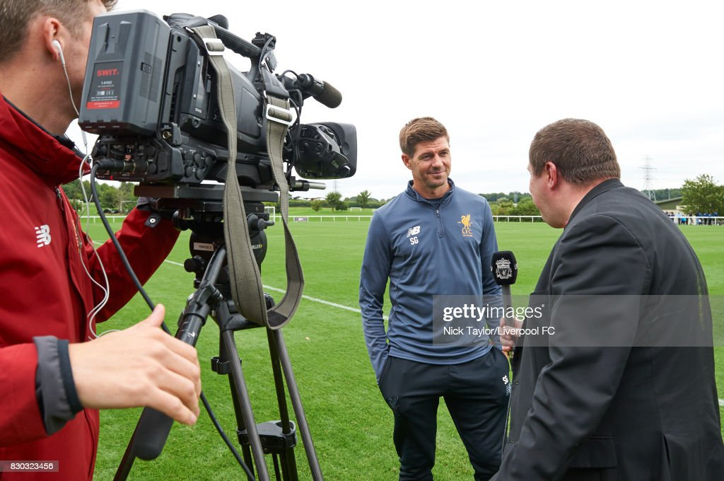 Liverpool U18 manager Steven Gerrard is interviewed by Steve Hunter of LFC TV after the Derby County v Liverpool U18 Premier League game at the Derby County Academy on August 11, 2017 in Derby, England.