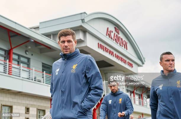 Liverpool U18 manager Steven Gerrard makes his way from the Academy building for his first home game in charge followed by his staff Scott Mason and...