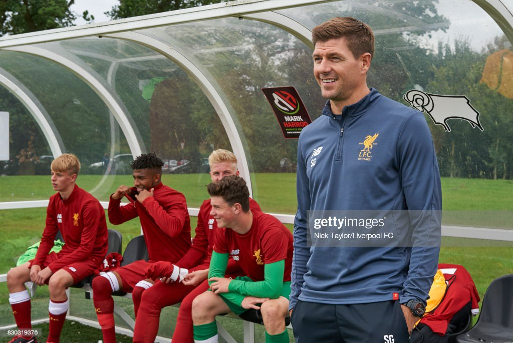 Liverpool U18 manager Steven Gerrard takes his place in the dug-out for the Derby County v Liverpool U18 Premier League game at the Derby County Academy on August 11, 2017 in Derby, England.