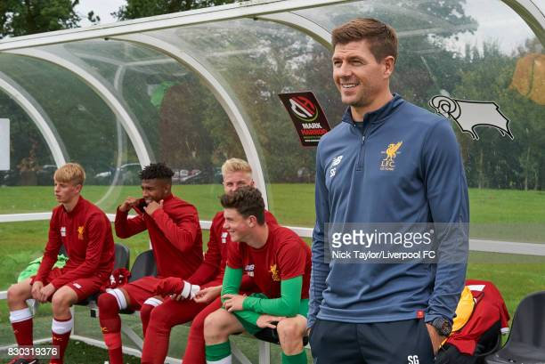Liverpool U18 manager Steven Gerrard takes his place in the dugout for the Derby County v Liverpool U18 Premier League game at the Derby County...