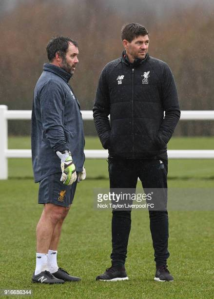 Liverpool U18 manager Steven Gerrard talks to goalkeeping coach Neil Edwards before the Everton v Liverpool U18 Premier League game at USM Finch Farm...