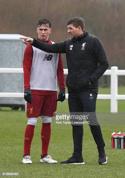 Liverpool U18 manager Steven Gerrard talks to Liam Millar before the Everton v Liverpool U18 Premier League game at USM Finch Farm on February 10...