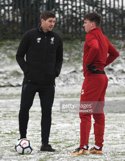Liverpool U18 manager Steven Gerrard talks to Liam Millar during the Manchester United v Liverpool U18 Premier League game at The Cliff on December 9...