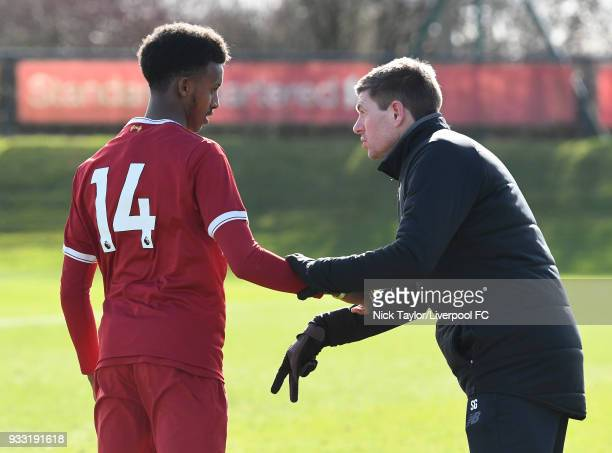 Liverpool U18 manager Steven Gerrard talks with Abdi Sharif during the Liverpool v Middlesbrough U18 Premier League game at The Kirkby Academy on...
