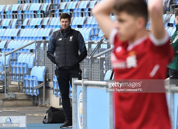 Liverpool U18 manager Steven Gerrard watches Adam Lewis take a throw in during the Manchester City v Liverpool UEFA Youth League game at Manchester...