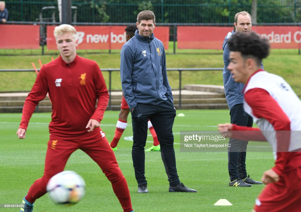 Liverpool U18 manager Steven Gerrard watches his players during the warm-up before the Liverpool v Blackburn Rovers U18 Premier League game at The Kirkby Academy on August 19, 2017 in Liverpool, England.