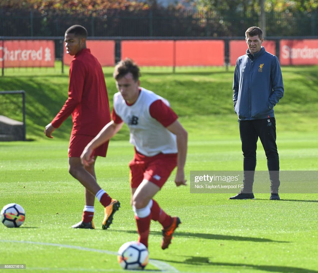 Liverpool U18 manager Steven Gerrard watches his players warm up before the U18 friendly match between Liverpool and Burnley at The Kirkby Academy on October 6, 2017 in Kirkby, England.