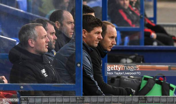 Liverpool U18 manager Steven Gerrard with Neil Critchley and Jordan Milson during the Liverpool v Manchester United UEFA Youth League game at Prenton...