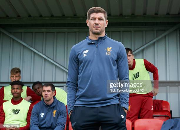 Liverpool U18 manger Steven Gerrard takes his place in the home dugout for his first home game in charge before the Liverpool v Blackburn Rovers U18...