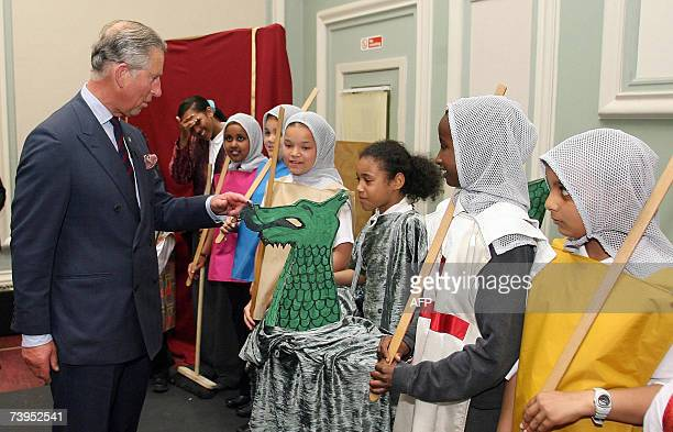 Britain's Prince Charles meets members of the cast of a Mummers play from St Margaret Antioch primary school at Toxteth Town Hall in Liverpool...