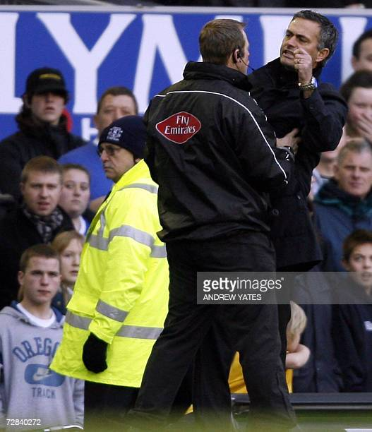 Chelsea manager Jose Mourinho is held back by the fourth official after complaining about an Andy Johnson dive during their English Premiership...